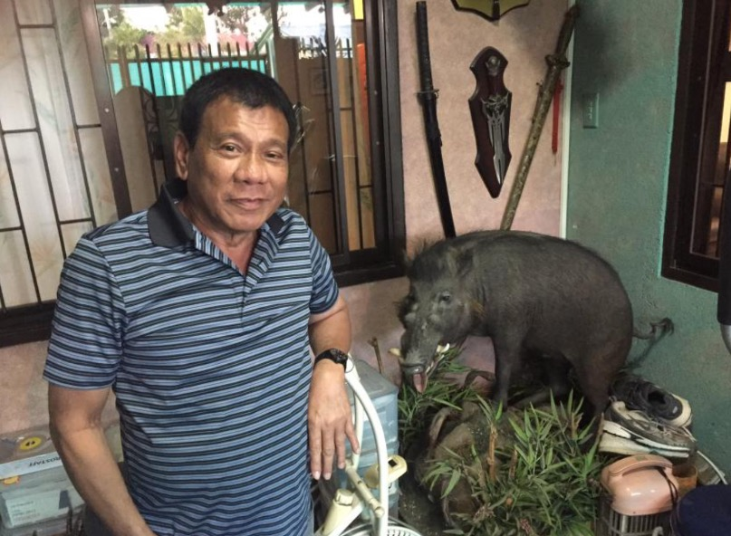 Duterte and the boar he shot