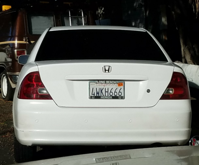 Car with 666 license plate towed from church parking lot